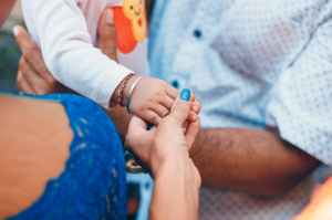 woman holding child hand